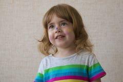 Retrato de una niña con una cara pintada Foto de archivo libre de regalías