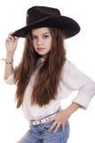 Retrato de una niña hermosa en un sombrero de vaquero negro Imagen de archivo libre de regalías