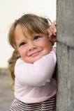 Retrato de una pequeña muchacha sonriente Fotografía de archivo