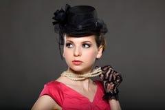 Retrato de una señora en un sombrero Foto de archivo libre de regalías