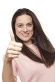 Retrato de una señora joven feliz que muestra un pulgar para arriba Imagen de archivo libre de regalías