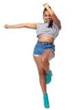 Retrato de una señora joven alegre en actitud de la danza Foto de archivo libre de regalías