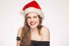 Retrato del Año Nuevo de las mujeres en el casquillo rojo aislado en blanco Fotografía de archivo libre de regalías