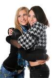 Retrato del abarcamiento feliz de dos muchachas Foto de archivo
