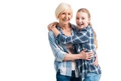 Retrato del abarcamiento feliz de la abuela y de la nieta Imagen de archivo