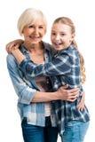 Retrato del abarcamiento feliz de la abuela y de la nieta Imagen de archivo libre de regalías