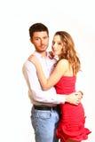 Retrato del abrazo joven de los pares aislado en el fondo blanco Fotografía de archivo libre de regalías