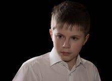 Retrato del adolescente aislado en fondo negro Foto de archivo libre de regalías