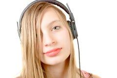 Retrato del adolescente con el auricular Imagenes de archivo