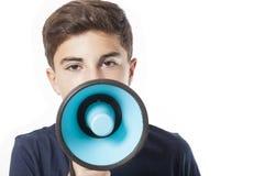 Retrato del adolescente con el megáfono Foto de archivo