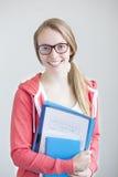 Retrato del adolescente con el trabajo de la escuela Fotos de archivo libres de regalías