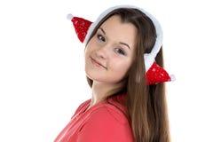 Retrato del adolescente con los auriculares de Navidad Fotos de archivo libres de regalías