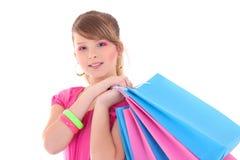 Retrato del adolescente en rosa con los bolsos de compras Fotografía de archivo