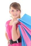 Retrato del adolescente feliz con los bolsos de compras Foto de archivo libre de regalías