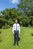 Retrato del adolescente joven en traje Fotos de archivo