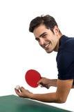 Retrato del atleta de sexo masculino feliz que juega a tenis de mesa Fotos de archivo libres de regalías