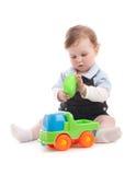 Retrato del bebé adorable que juega con los juguetes Imagenes de archivo