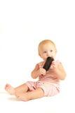 Retrato del bebé joven que juega con el peine Imagen de archivo libre de regalías
