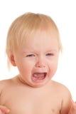 Retrato del bebé que se sienta joven gritador Fotografía de archivo libre de regalías