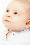 Retrato del bebé sobre blanco Foto de archivo