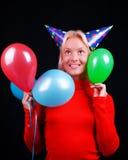 Retrato del blonde atractivo con los globos Imagen de archivo