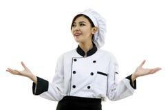 Retrato del cocinero de la mujer joven en el fondo blanco Fotografía de archivo libre de regalías