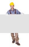 Retrato del contratista feliz que lleva a cabo el cartel Fotografía de archivo