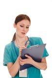Retrato del doctor de sexo femenino en el uniforme verde Fotos de archivo