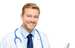 Retrato del doctor joven confiado en el fondo blanco Imagen de archivo