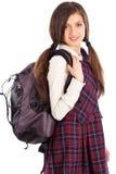 Retrato del estudiante con la mochila aislada en el fondo blanco Fotografía de archivo