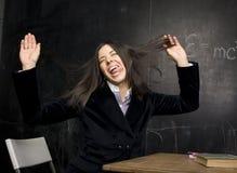 Retrato del estudiante lindo feliz en sala de clase Fotografía de archivo