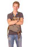 Retrato del estudiante sonriente feliz con la mochila aislada en pizca Foto de archivo libre de regalías