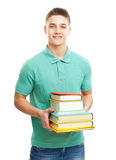 Retrato del estudiante sonriente que sostiene los libros Imagen de archivo libre de regalías