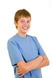 Retrato del estudiante sonriente sobre blanco. Fotografía de archivo