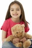 Retrato del estudio de la muchacha sonriente con el oso del peluche Fotos de archivo libres de regalías