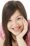 Retrato del estudio del adolescente sonriente Fotografía de archivo
