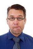 Retrato del friki nerdy que hace la cara divertida Foto de archivo libre de regalías