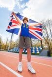 Retrato del ganador adolescente con la bandera británica Fotos de archivo