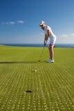 Retrato del golfista de la mujer joven Fotografía de archivo