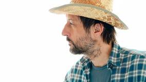 Retrato del granjero pensativo en el fondo blanco imagen de archivo libre de regalías