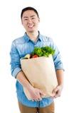 Retrato del hombre con el bolso de ultramarinos Imagen de archivo libre de regalías