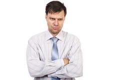 Retrato del hombre de negocios infeliz joven con los brazos doblados Fotografía de archivo libre de regalías