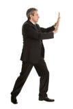 Retrato del hombre de negocios que empuja el copia-espacio Imagenes de archivo