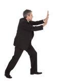 Retrato del hombre de negocios que empuja el copia-espacio Foto de archivo libre de regalías