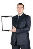 Retrato del hombre de negocios que lleva a cabo a una tarjeta en blanco fotografía de archivo libre de regalías