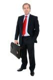 Retrato del hombre de negocios que sostiene una cartera Imagenes de archivo