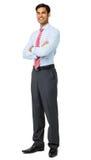 Retrato del hombre de negocios sonriente Standing Arms Crossed imagenes de archivo