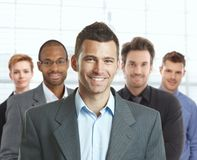 Retrato del hombre de negocios y del equipo felices Imagen de archivo