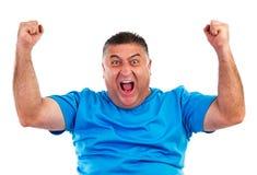 Retrato del hombre feliz con las manos levantadas hacia arriba fotos de archivo