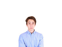 Retrato del hombre joven con la expresión facial chocada Retrato del adolescente sorprendido Imagen de archivo libre de regalías